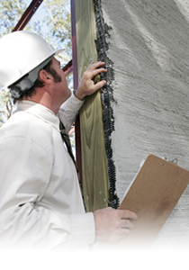 Man Inspecting Stucco - Stucco Contractors Barrie